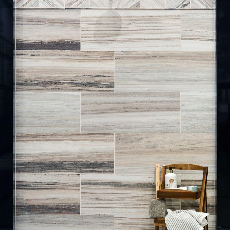 Skyline Honed 12 x 24 (wall bottom), Chevron (wall top) & 2 x 2 Multi Finish Hex (floor)