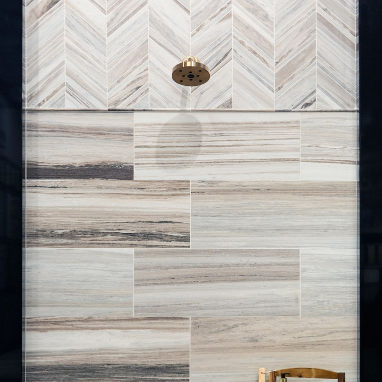 CS-Skyline Honed Chevron (top wall), 12 x 24 (bottom wall) & 2 x 2 Multi Finish Hex (floor)