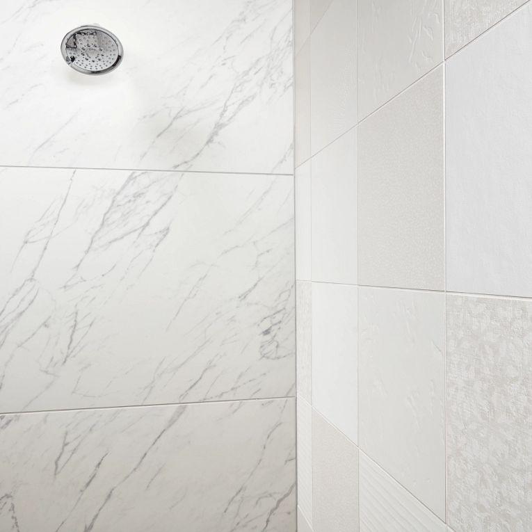 Tru Marmi Venatino Polished 24 x 48 (wall left) & Chymia Mix 1 White 12 x 12 (wall right)